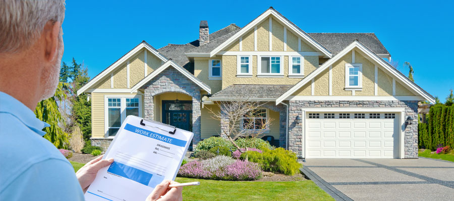 Insurance adjuster with clipboard evaluating home   Amerestore