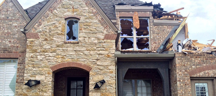 Home with severe exterior damage | Amerestore